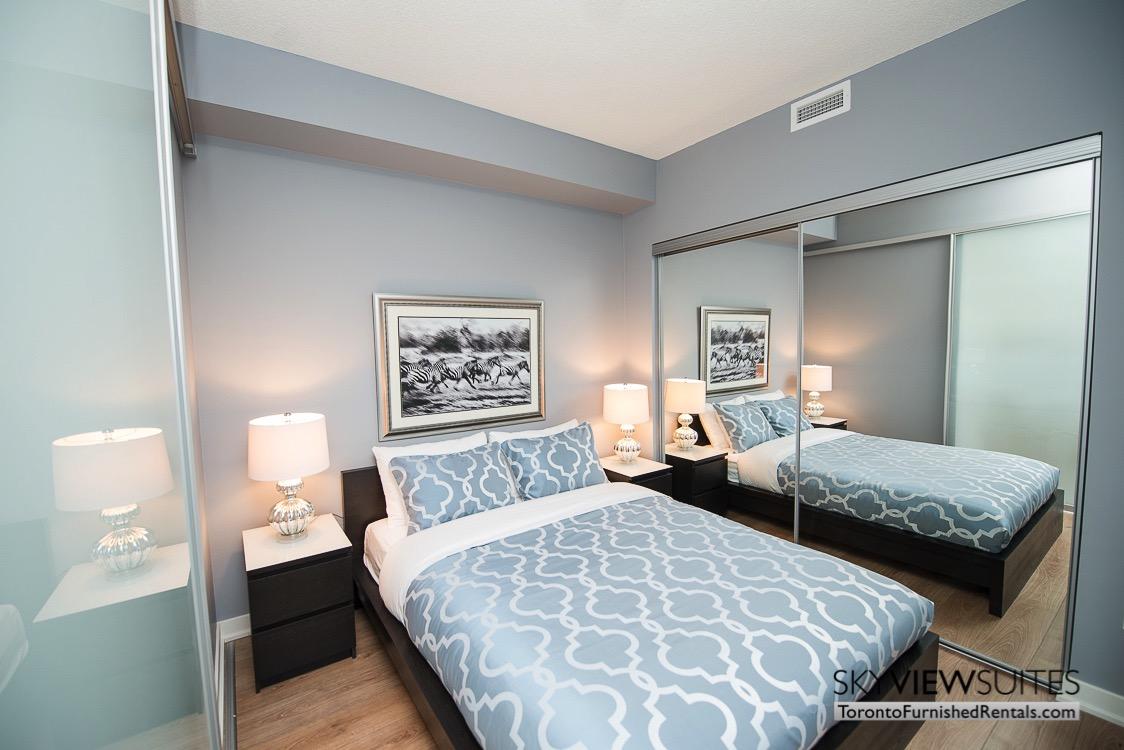 King West corporate rentals toronto blue bedroom