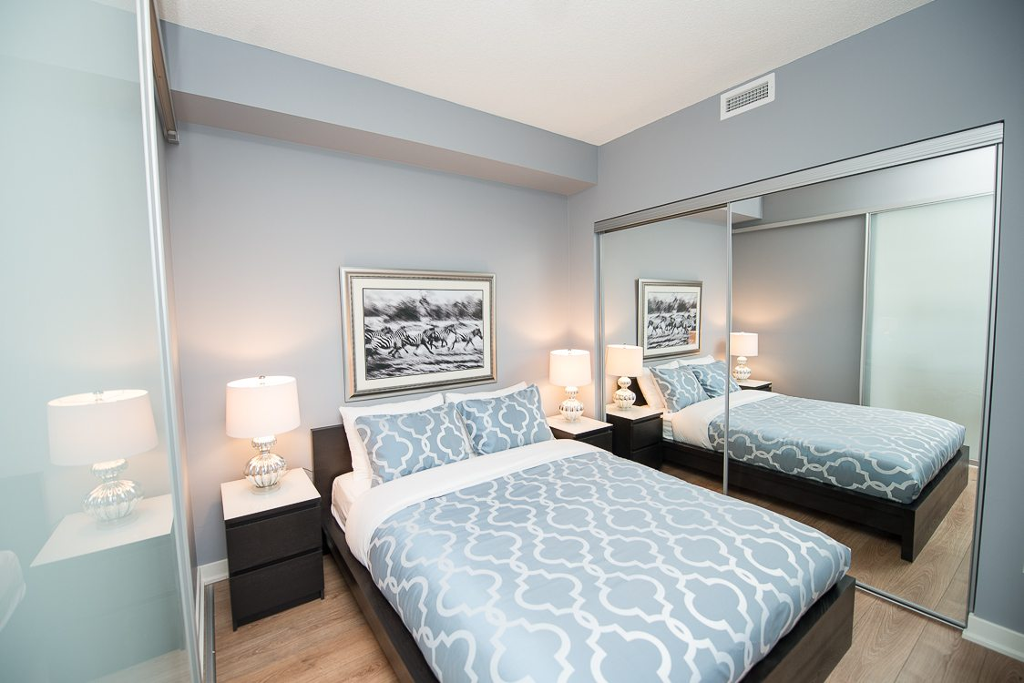 King West furnished blue bedroom
