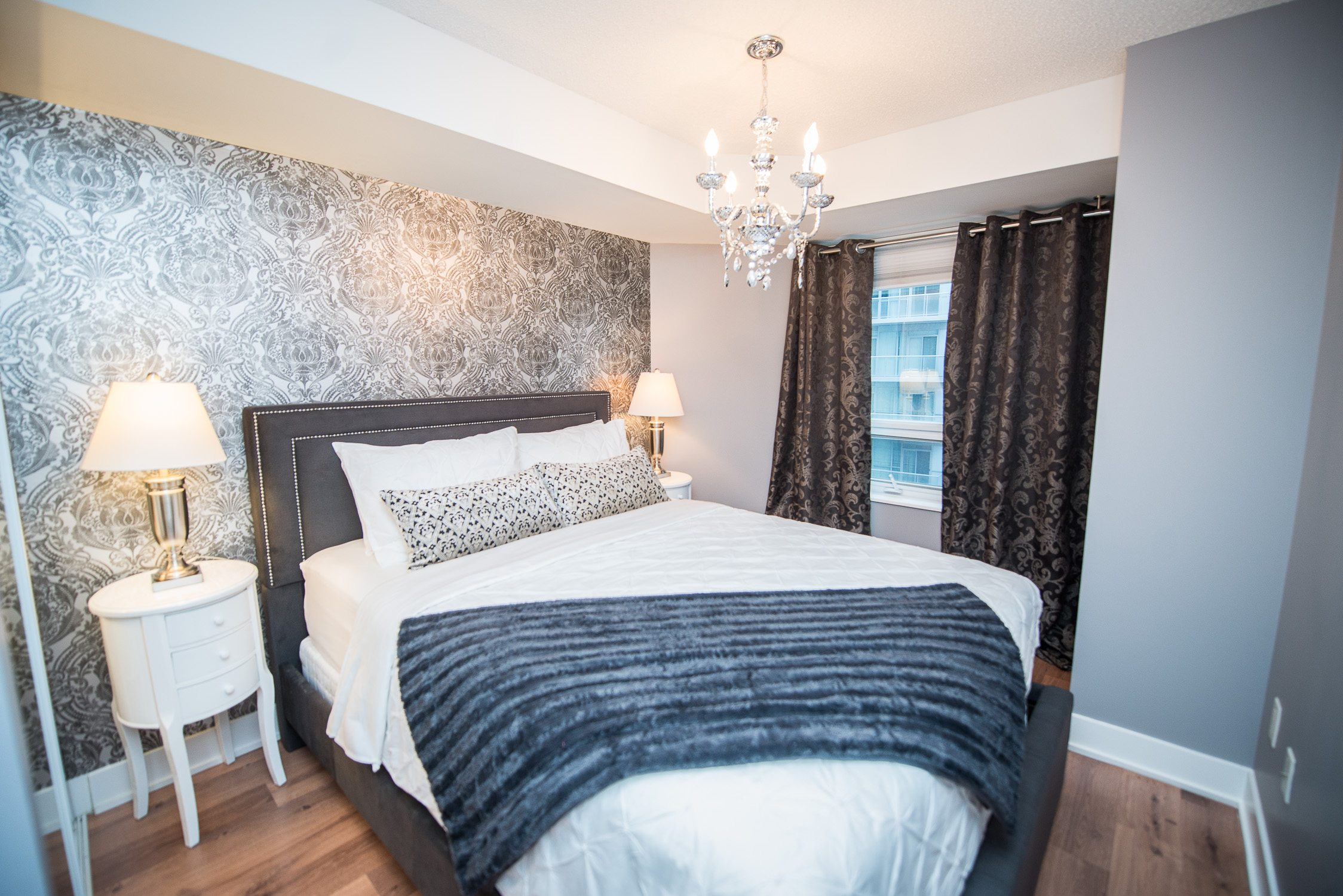 blue throw on bedroom toronto furnished apartment