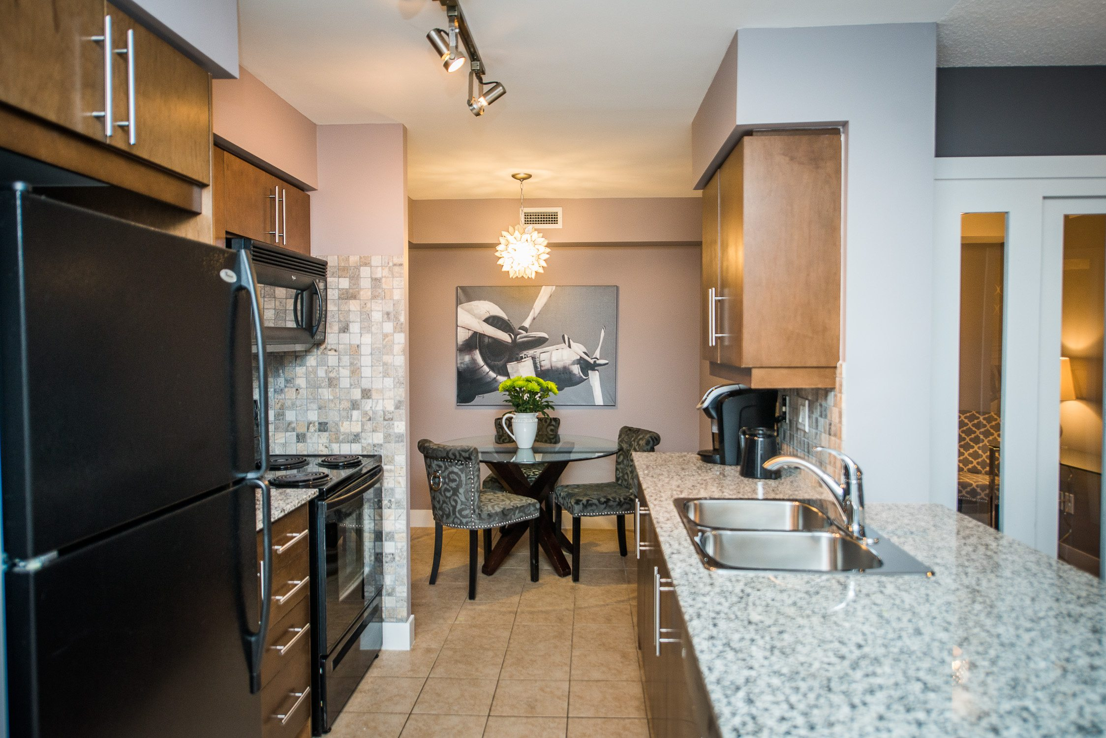 kitchen and dining room in toronto furnished apartment in king west