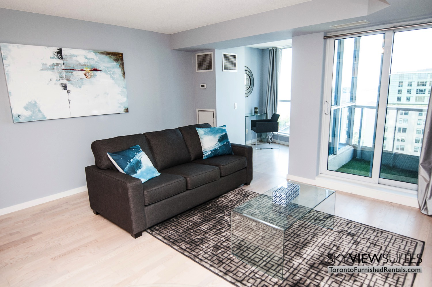 furnished rentals toronto waterfront blue pillow couch