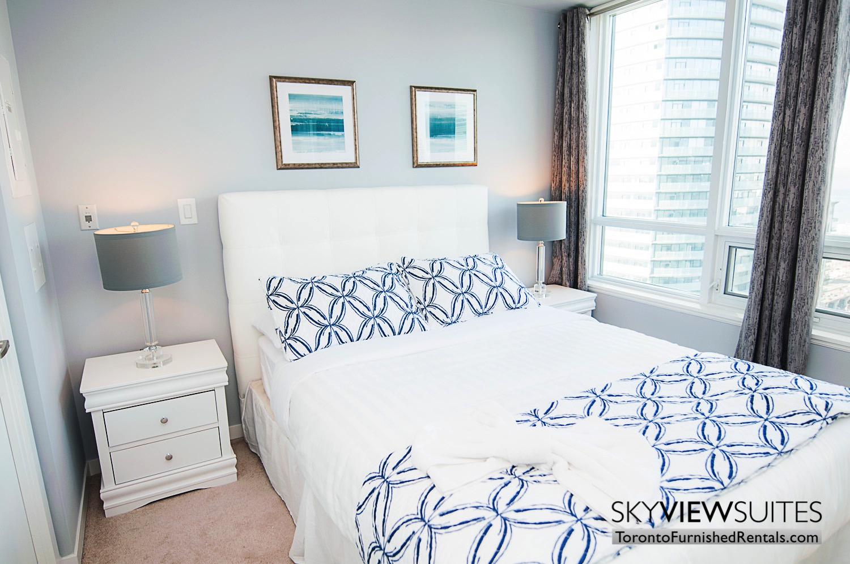MLS furnished condo toronto grey lamps bedroom