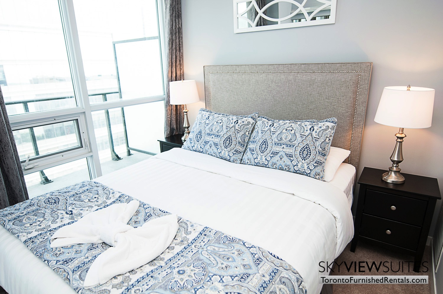MLS furnished condo toronto bedroom blue pillows