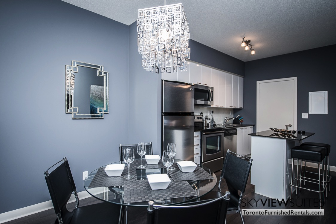 Cityplace corporate rentals Toronto dining table wine glasses
