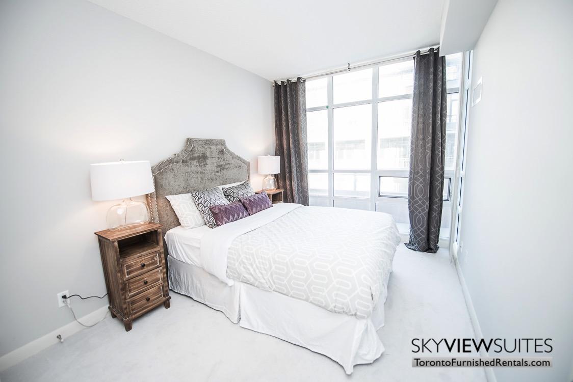 Cityplace corporate rentals Toronto bedroom bedroom side table