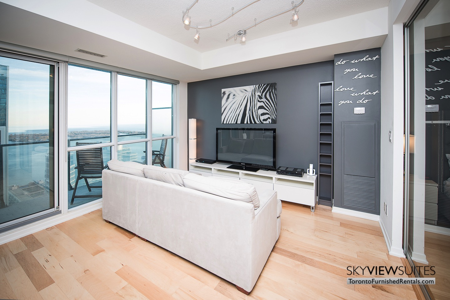 MLS furnished condo toronto couch and balcony