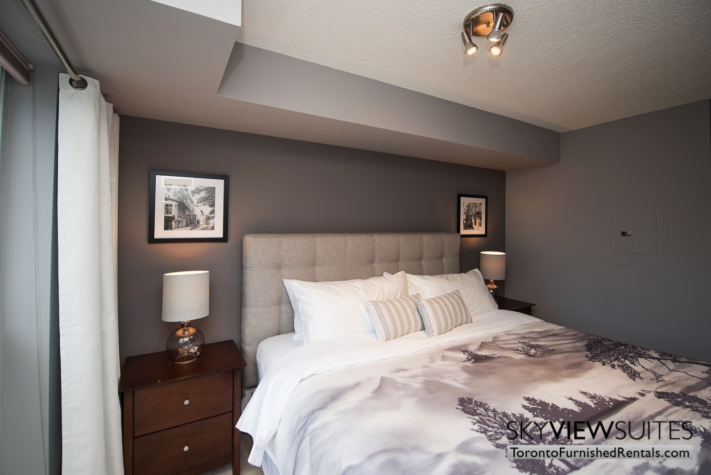 Adelaide & Sherbourne executive rentals toronto gray bedroom wall
