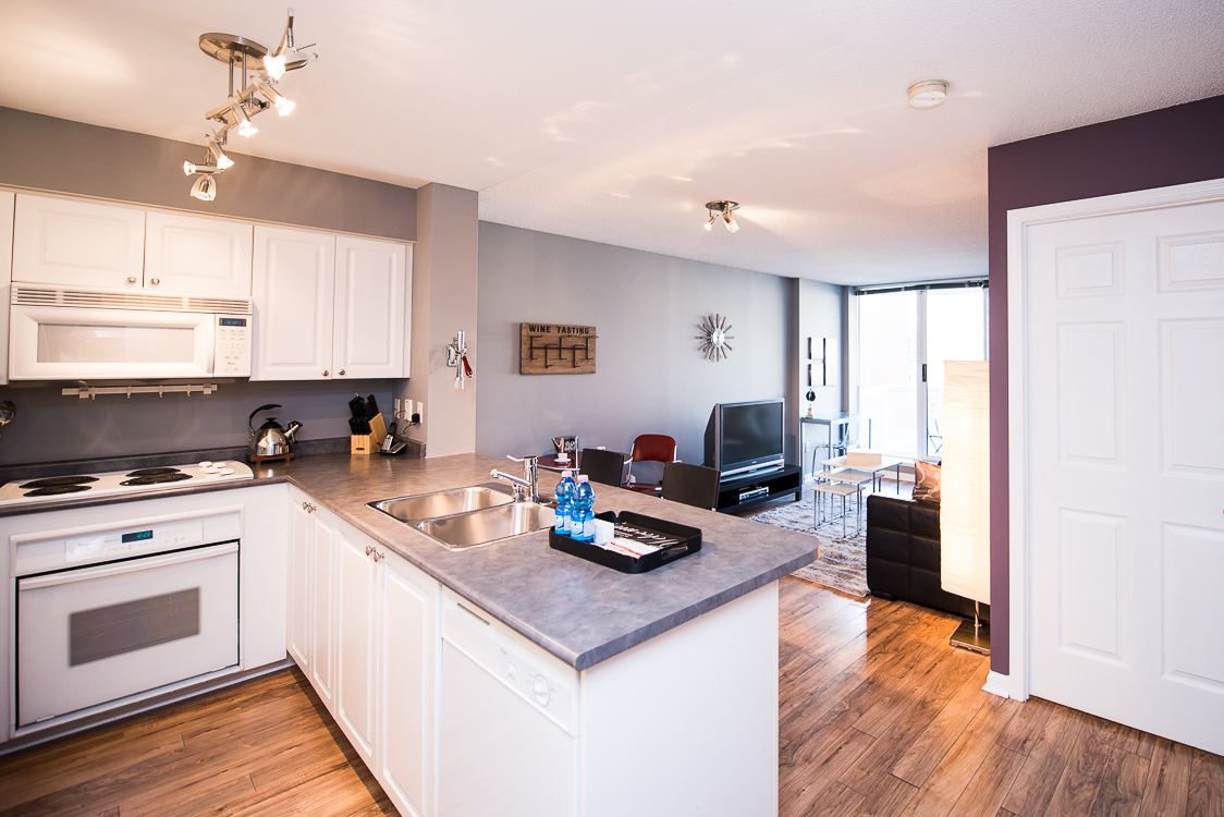 Adelaide & Sherbourne executive rentals toronto kitchen and living room