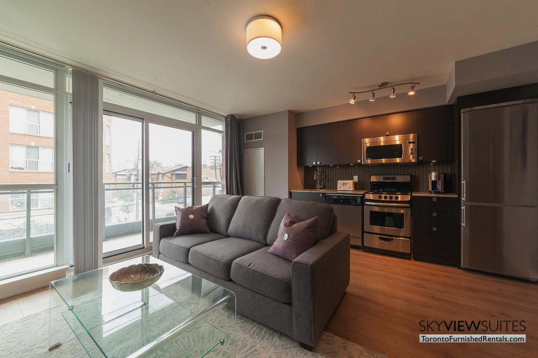 King west corporate rentals toronto purple pillows and balcony King west corporate rentals toronto