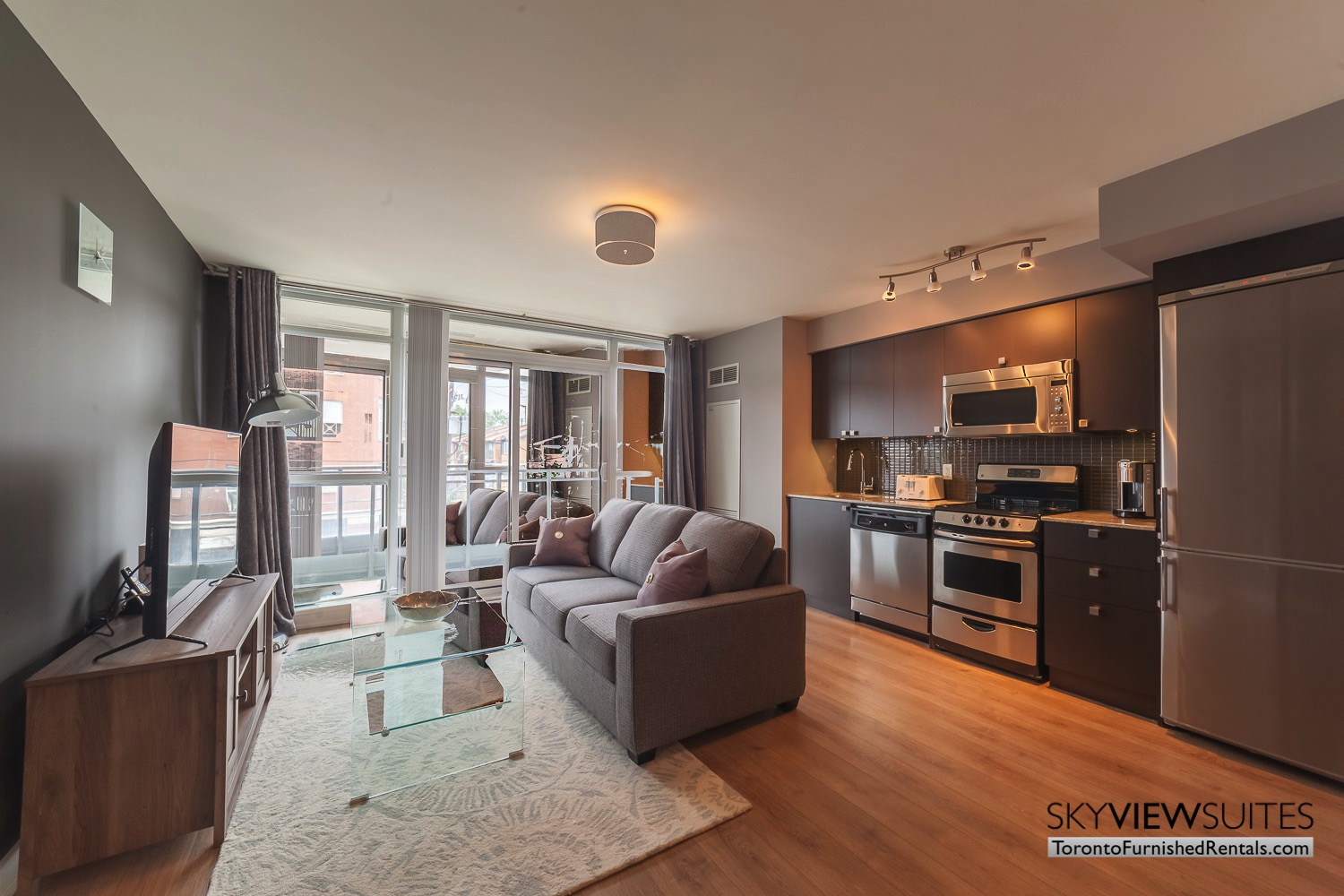 living room and tv King west corporate rentals toronto