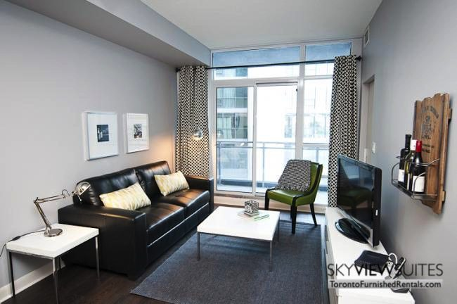 LTD corporate rentals toronto couch and green chair