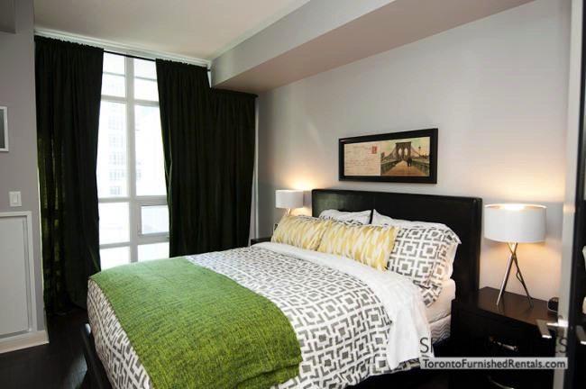 LTD corporate rentals toronto green throw blanket bedroom