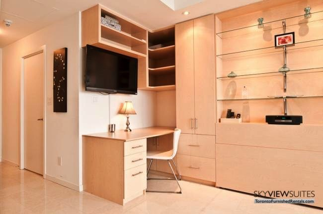 short-term-rentals-toronto-living-room-maple-leaf-square
