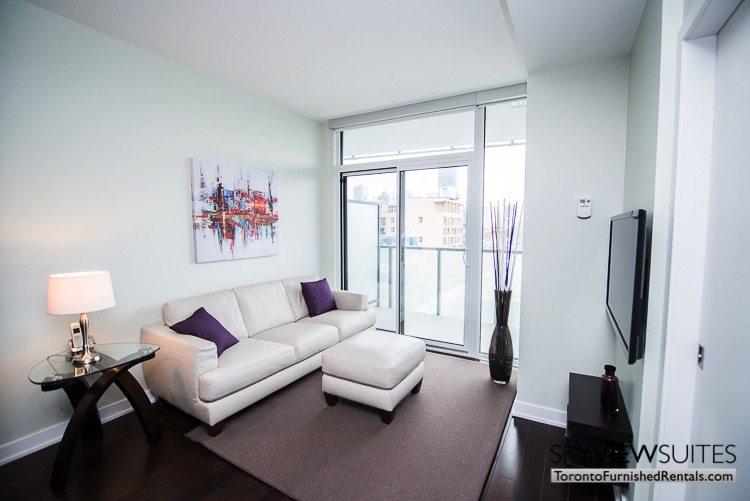 Market Street Toronto corporate rentals toronto den with purple pillows