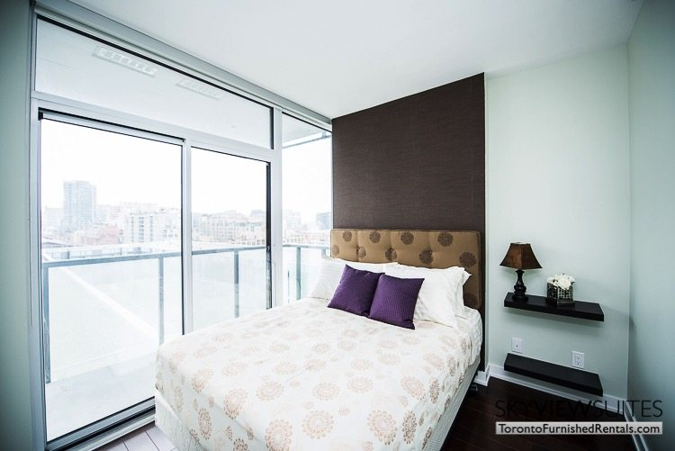 Market Street Toronto corporate rentals toronto bedroom purple pillows