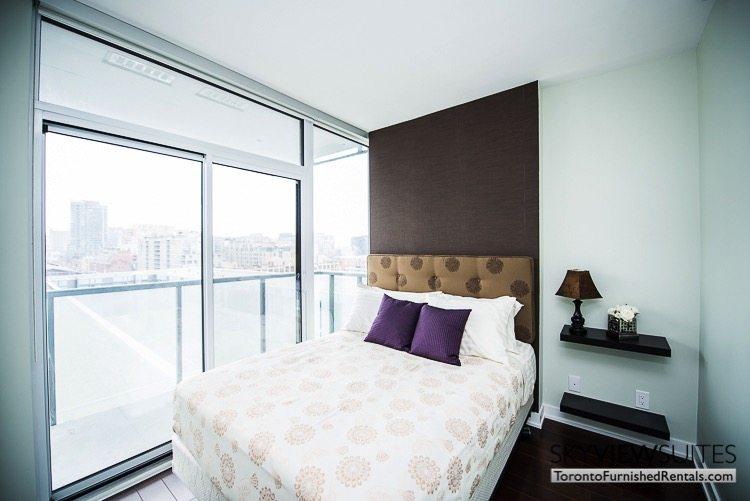 Market Street Toronto corporate rentals toronto bedroom purple pillows