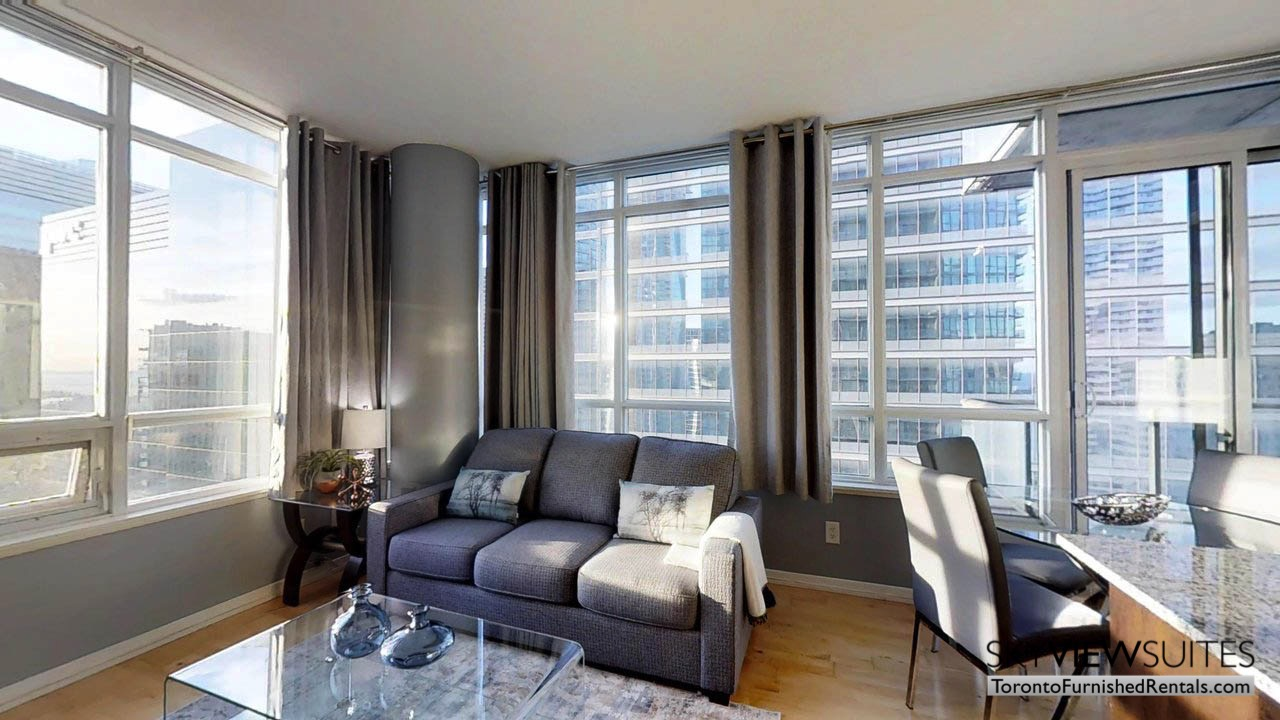 furnished rentals toronto york and bremner living room with windows and lighting