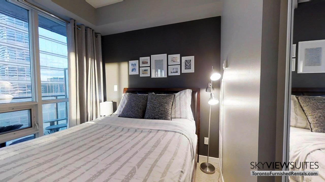 furnished rentals toronto york and bremner bedroom with balcony in room