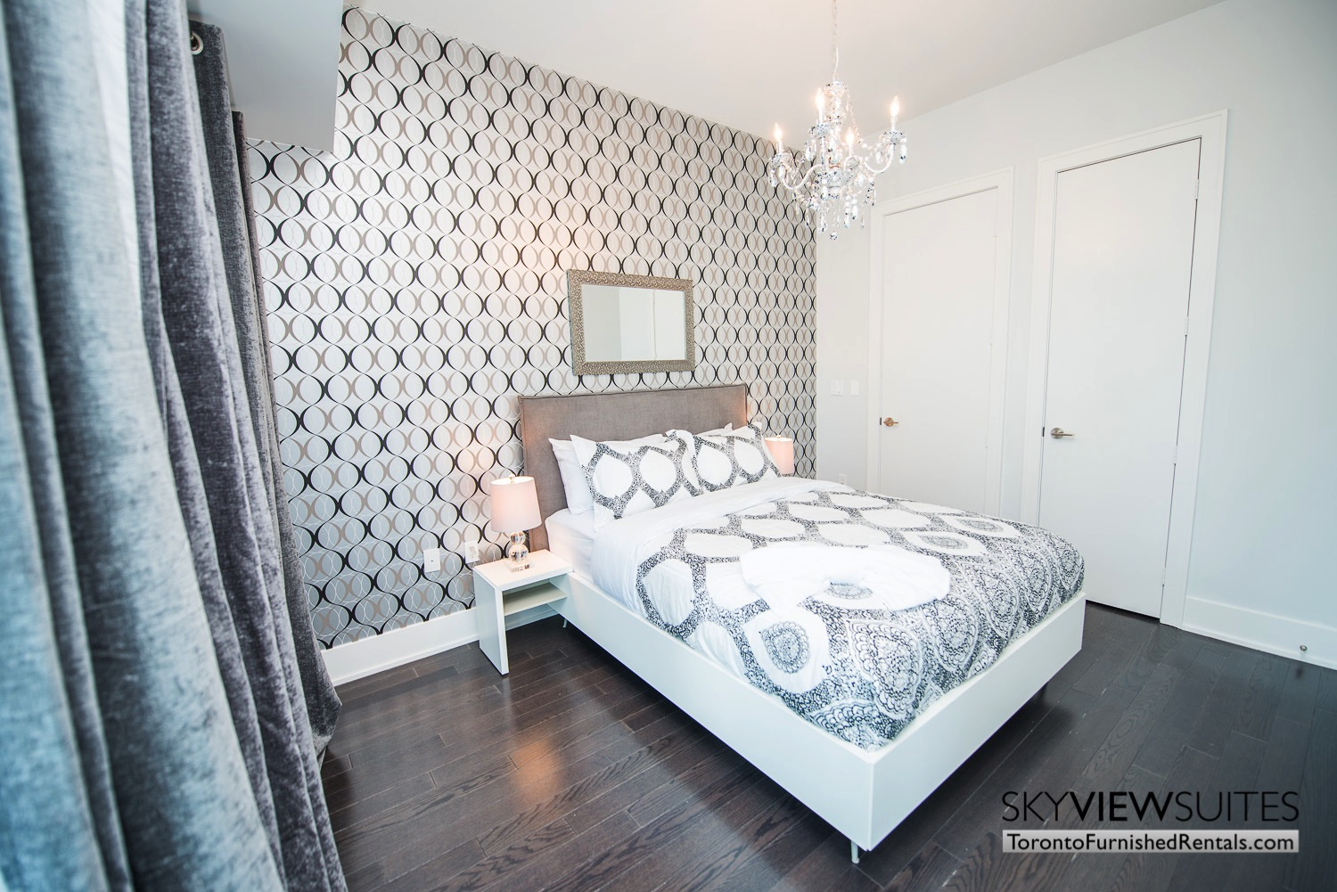 executive rentals toronto 39 Queens Quay bedroom with patterned wallpaper