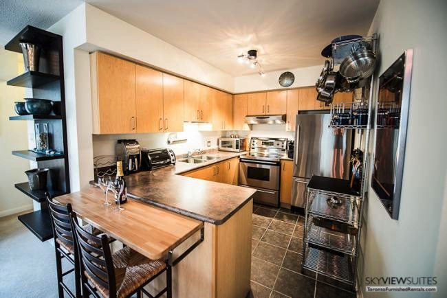 Liberty Village serviced apartments toronto kitchen with toaster oven and refrigerator