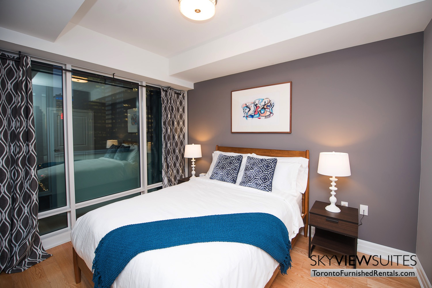 Yonge & Front serviced apartments toronto blue throw in bedroom