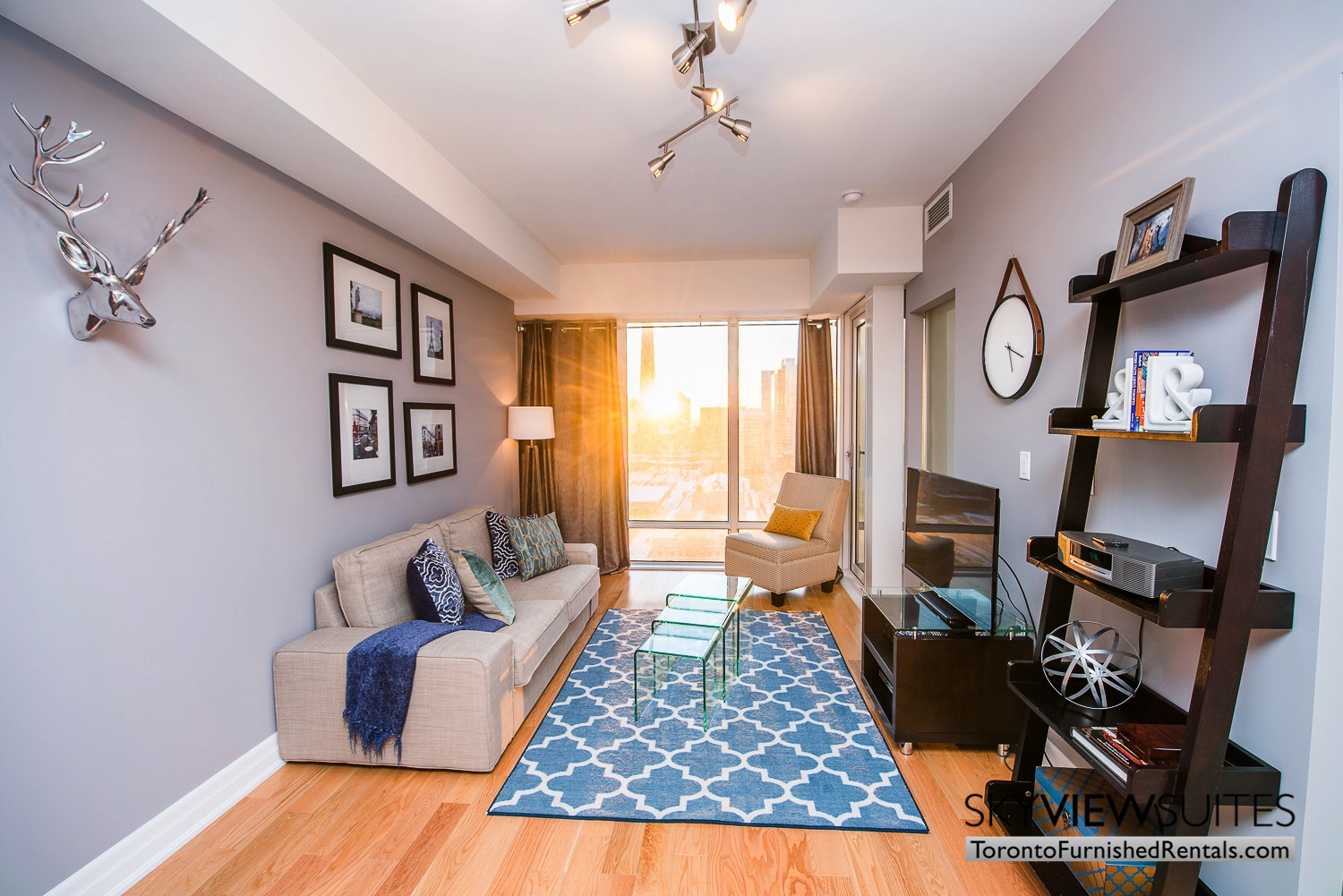 Yonge & Front serviced apartments toronto blue rug and wall clock
