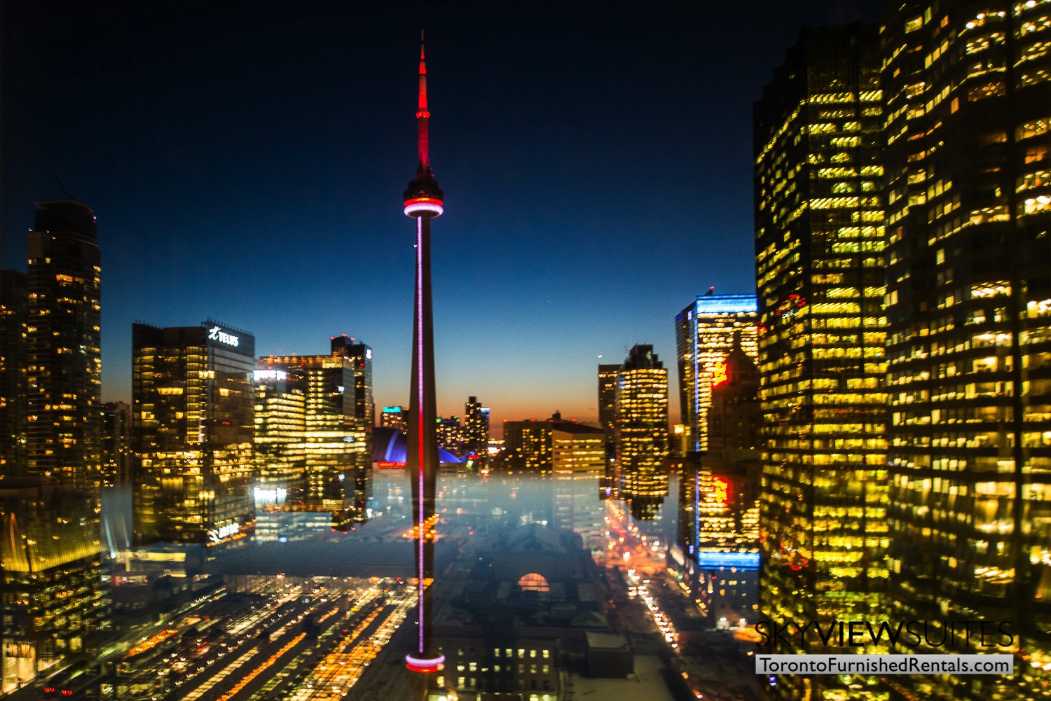 Yonge & Front serviced apartments toronto skyline evening