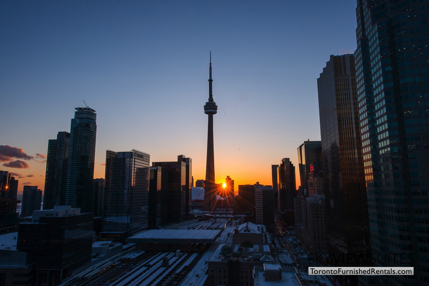 Yonge & Front serviced apartments toronto skyline sunset