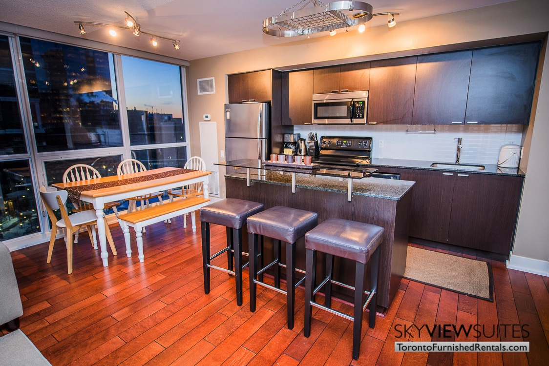 Yonge and Sheppard serviced apartments toronto kitchen table and counter