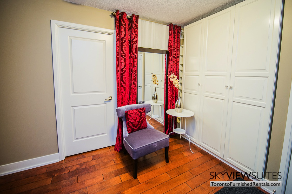 Yonge and Sheppard serviced apartments toronto red pillow living room
