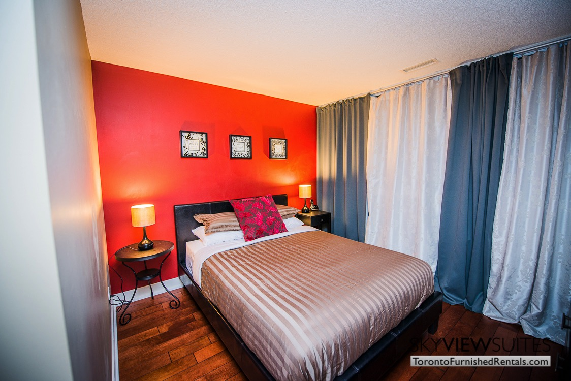 Yonge and Sheppard serviced apartments toronto bedroom with red wall