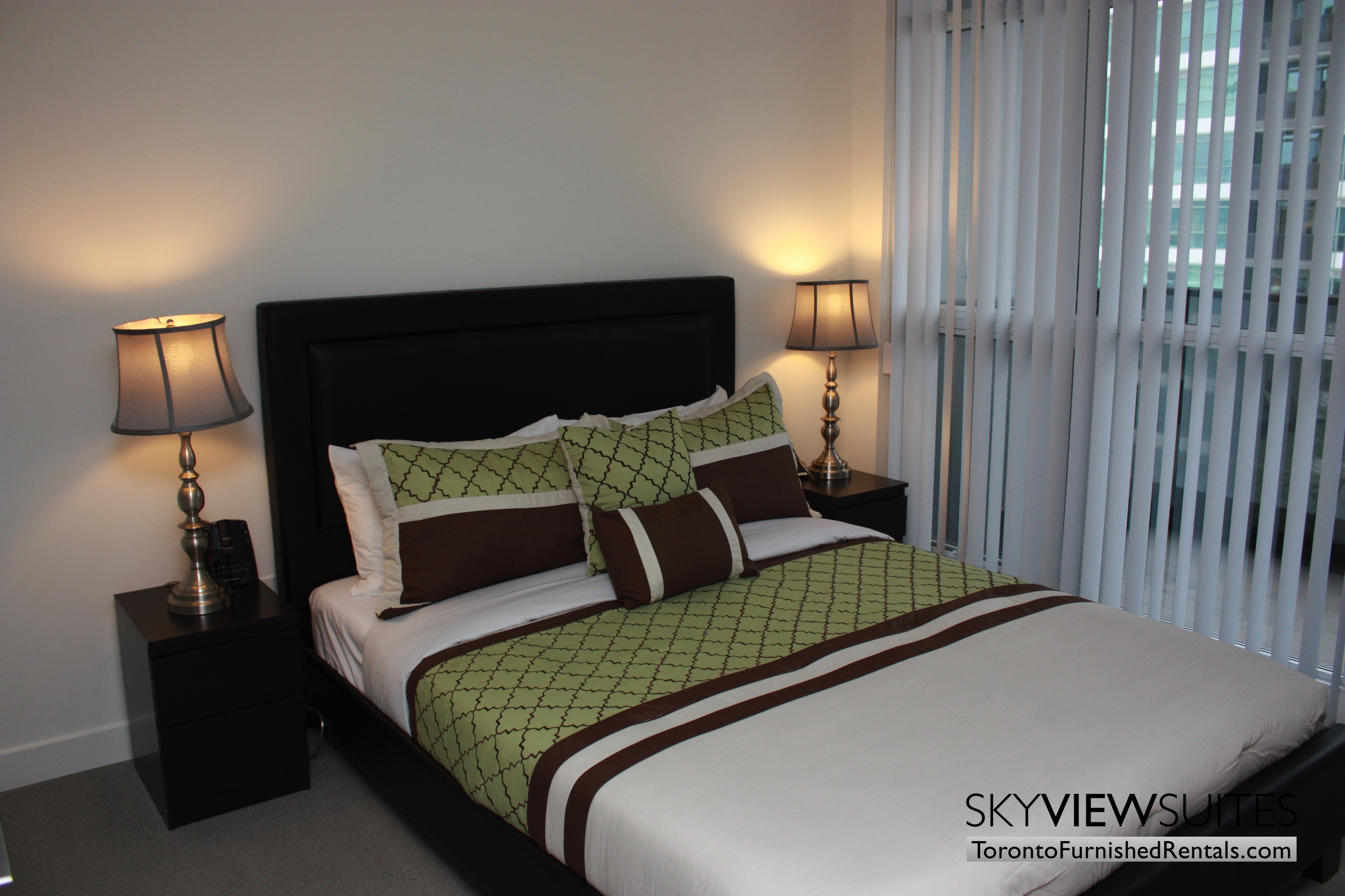 Leslie and Sheppard furnished suites toronto green pillow bedroom