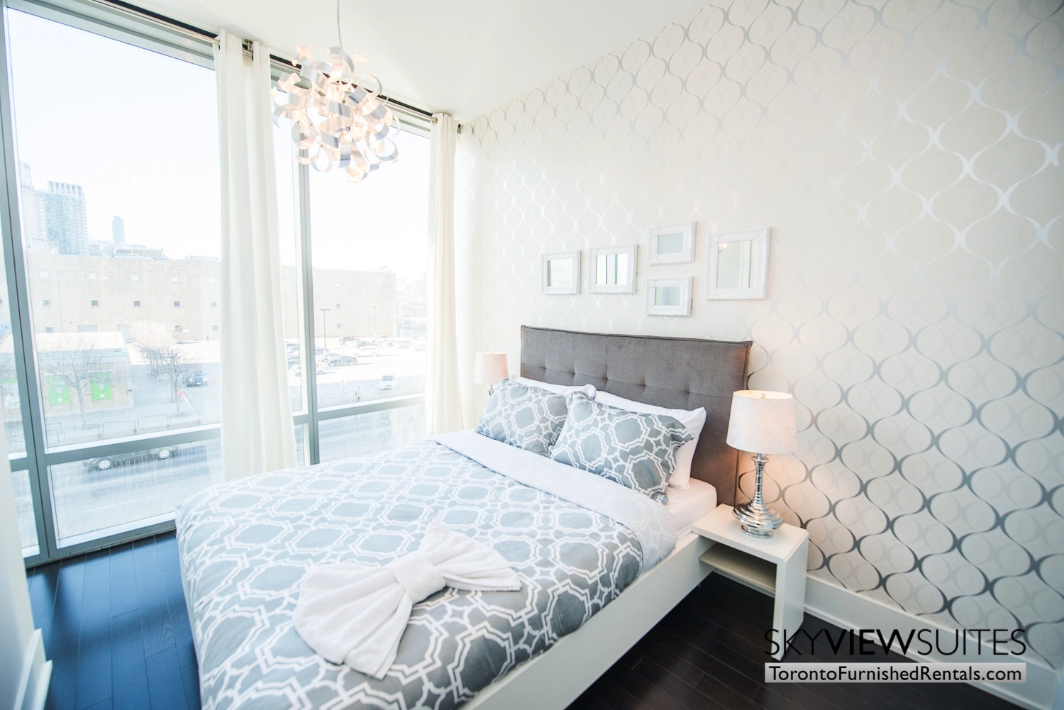 bedroom with hardwood floors 39 Queens Quay toronto corporate housing