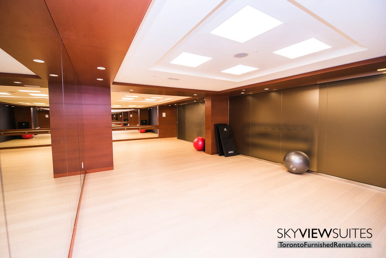 yoga room in 39 Queens Quay toronto corporate housing