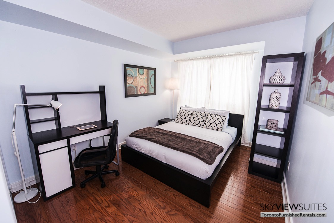 corporate rentals toronto Avondale bedroom with workspace