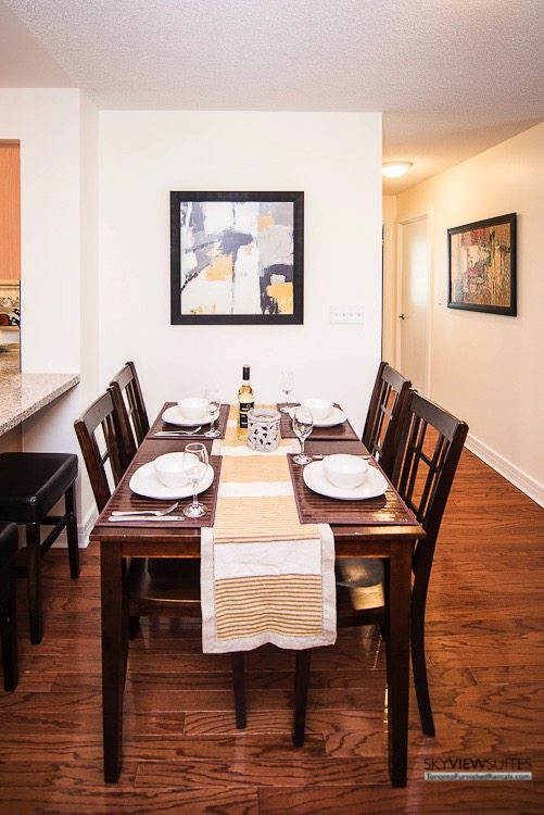 corporate rentals toronto Avondale dining table with bottle of wine