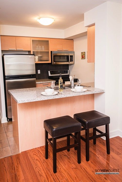 corporate rentals toronto Avondale kitchen with barstools