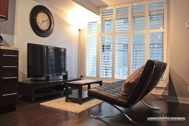 furnished apartments toronto boutique table and television living room