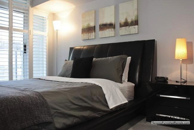 furnished apartments toronto boutique bedroom with nightstand and balcony doors
