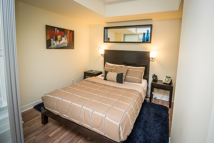 8 Colborne Street executive rentals toronto bedroom with blue rug