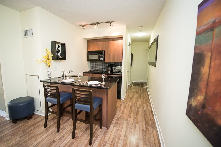 8 Colborne Street executive rentals toronto kitchen and dining table