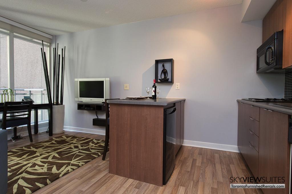 8 Colborne Street short term rental toronto kitchen and living room
