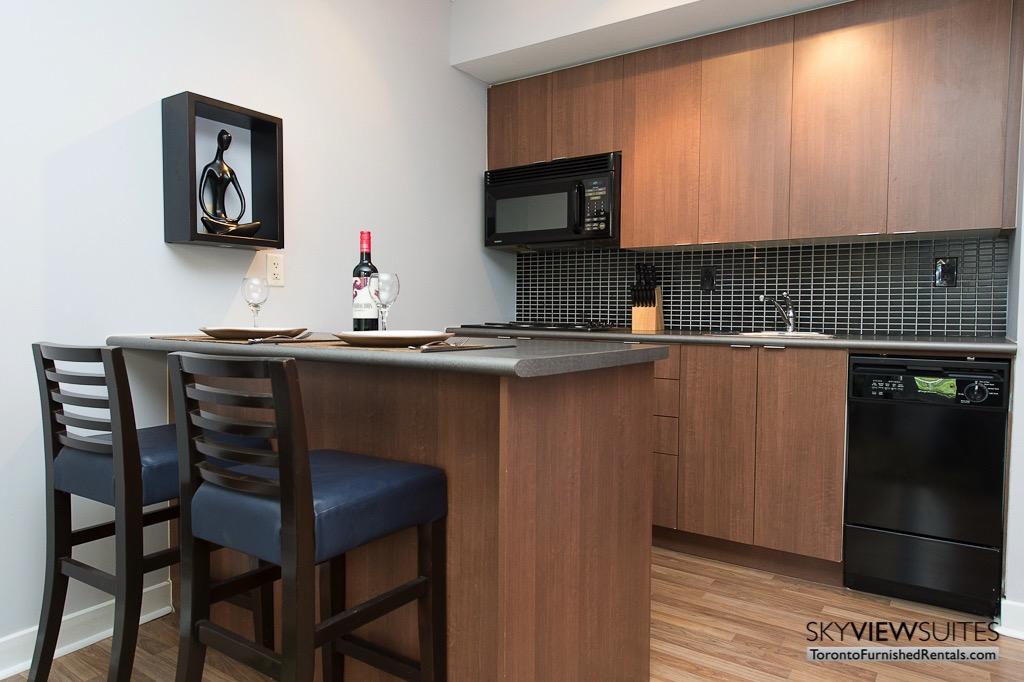 8 Colborne Street short term rental toronto kitchen island and bottle of red wine