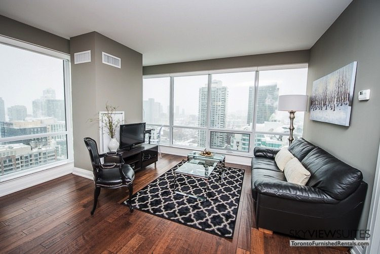 King and Spadina serviced apartments toronto living room with television