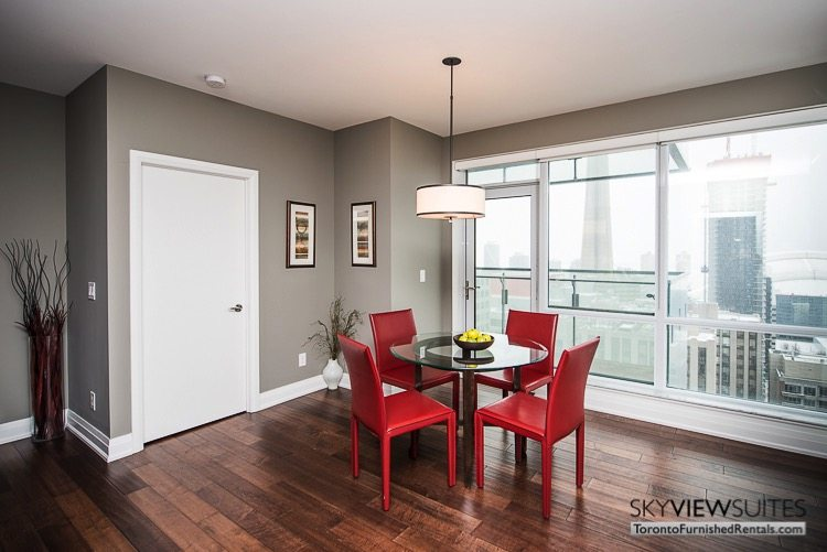 King and Spadina serviced apartments toronto dining table red chair
