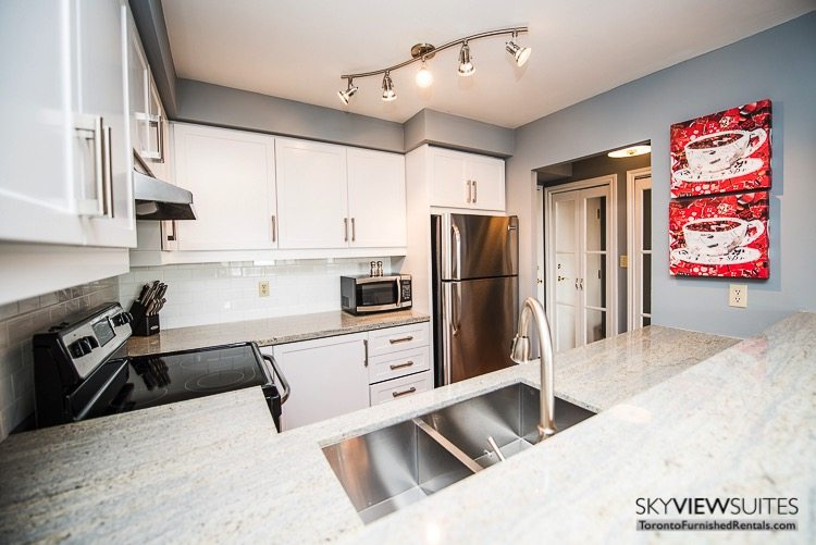serviced apartments toronto marina del ray kitchen with red coffee cup art
