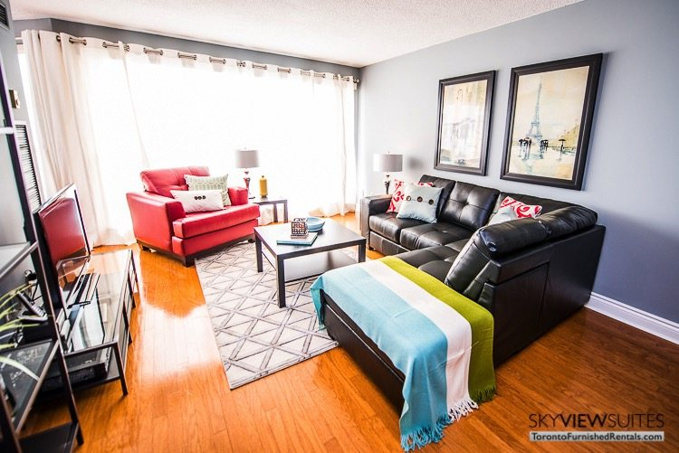serviced apartments toronto marina del ray living room couch and red chair