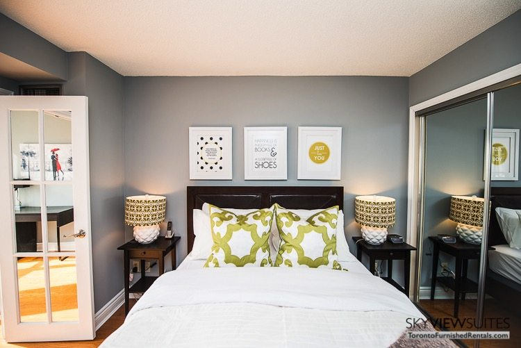 serviced apartments toronto marina del ray bedroom with green pillows and lovely art