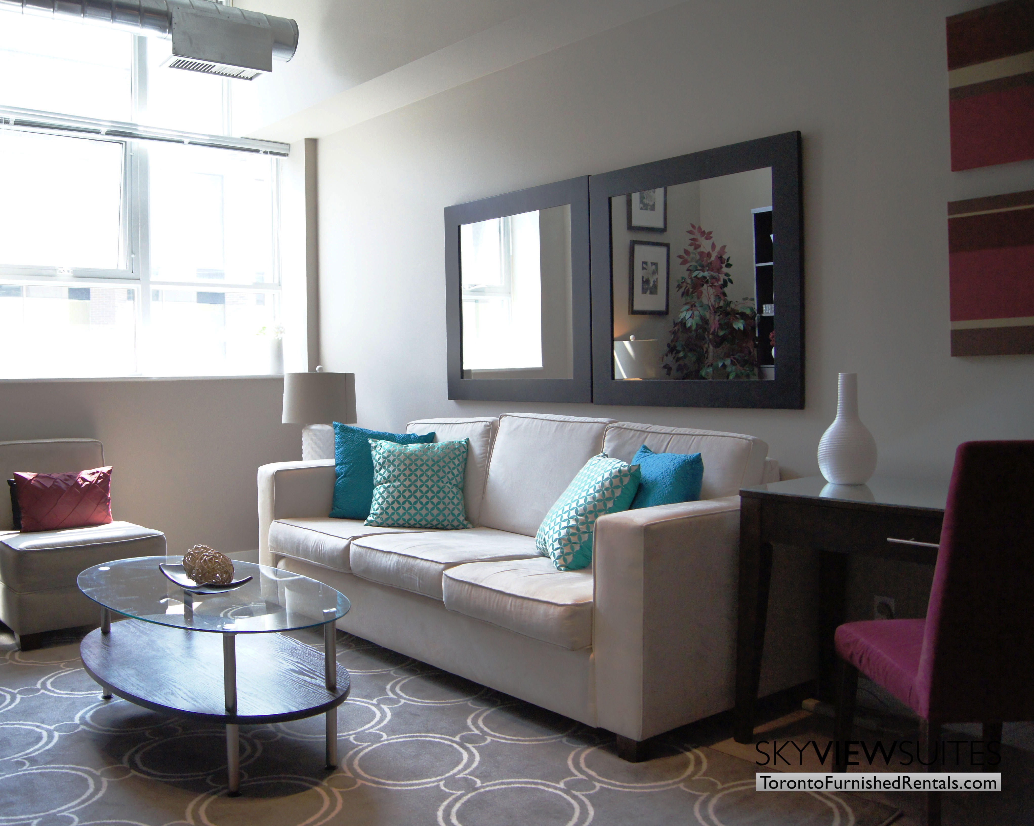 Church and Dundas toronto corporate housing couch in living room