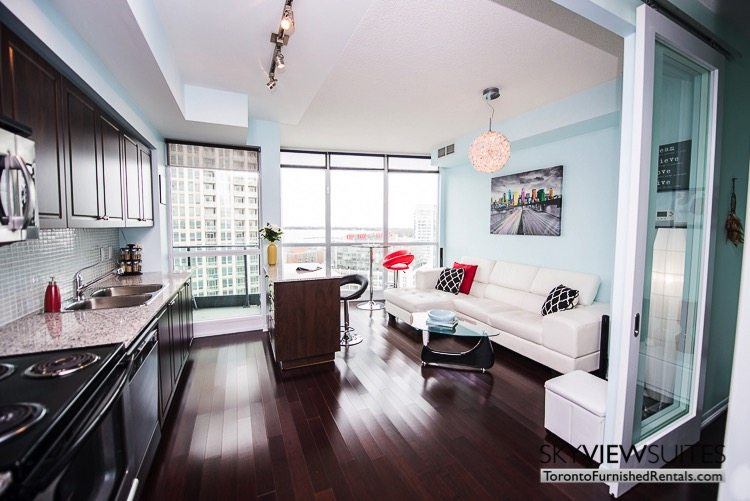 furnished suites toronto Neptune living room and kitchen with hardwood floors